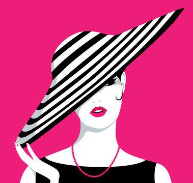Woman wearing large hat
