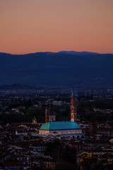 Fotobehang Eiffeltoren wide panorama during the sunset of the city of Vicenza and the famous monument called Basilica Palladiana with the tall Clock Tower. Vicenza, Veneto, Italy - April 2019