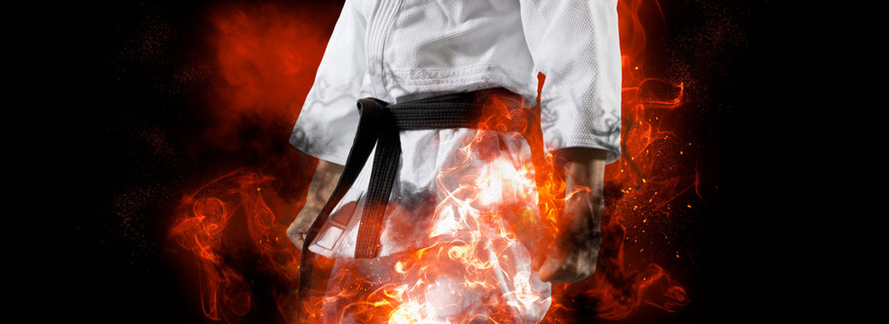 Guy poses in white kimono with black belt