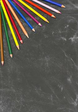 Portrait blackboard background with coloured pencils