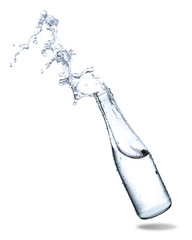 Water splash out of bottle glass isolated on white background.