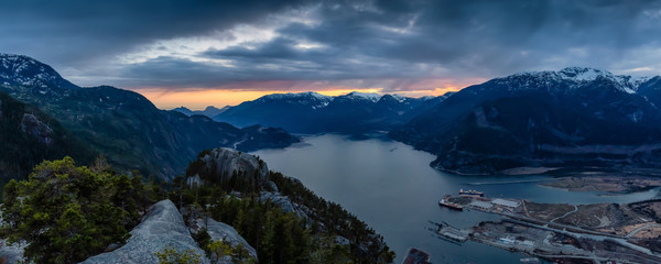 Scenic Panoramic Landscape view of the Beautiful Canadian Nature from the top of the Mountain during  a colorful sunset. Taken in Squamish, North of Vancouver, BC, Canada.