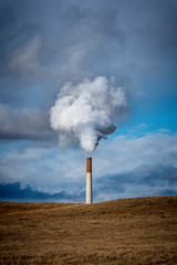 power plant Smokestack releasing pollution and steam