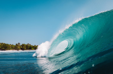 Wave breaking on a paradisiacal beach in Indonesia