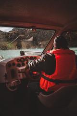 Boat Captain Navigating in the Rain