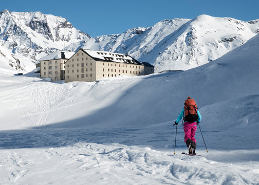 Switzerland, Great St Bernard Hospice, woman ski touring in the mountains