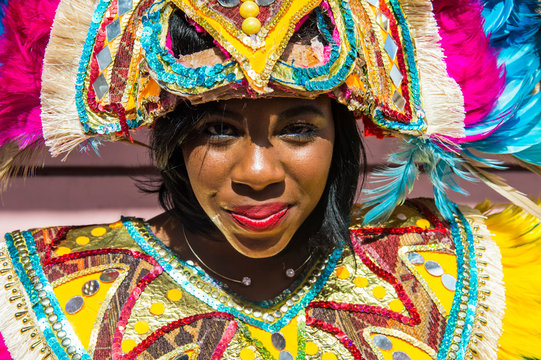 Bahamas, Nassau, Woman posing in a colorful carnival costume