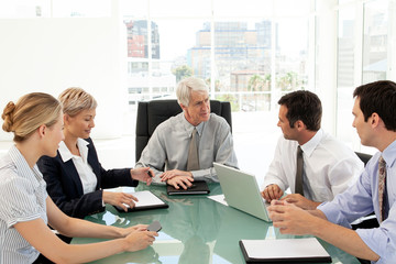 group of corporate business people at meeting with boss