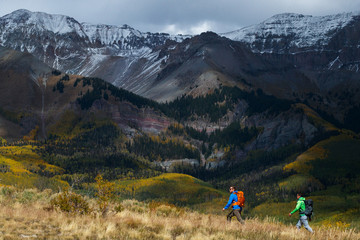 Two men with packs hiking in the San Juan Mountains near Telluride, Colorado.
