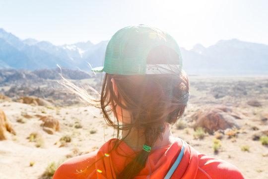 Rear view of woman wearing baseball cap