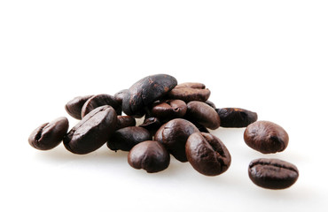 Wall Mural - Roasted Coffee Beans Against White Background
