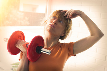 woman doing weights, sport and bodybuilding