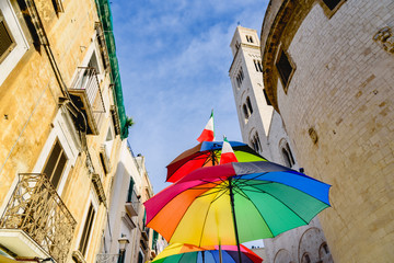 Funny colored umbrella with sky background in a city.