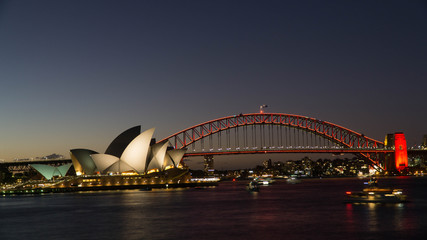 A Night view of the famous Sydney Opera House and the Harbour Bridge seen from Royal Botanical gardens, Australia