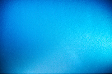Textural monotonous blue background with the transition to blur