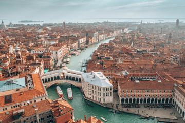 Fototapete - Aerial panoramic view of famous Canal Grande and famous Rialto Bridge at sunset in Venice, Italy.