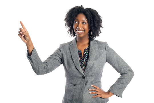Black African American female businesswoman isolated on a white background advertising and pointing up