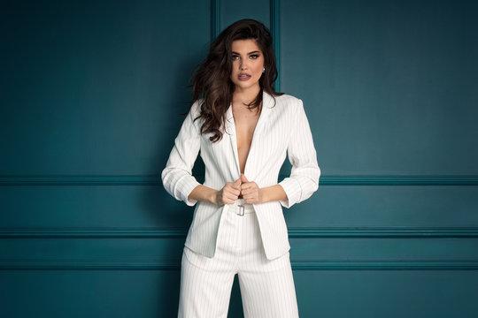 Beauty Fashion brunette model girl wearing stylish suit.