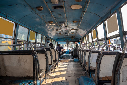 Inside of asian bus with empty old seats