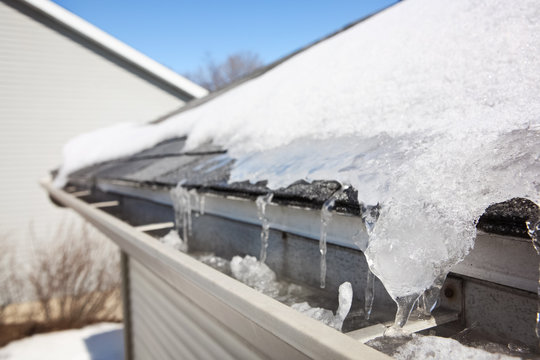 Ice on roof and gutters causing Ice dam