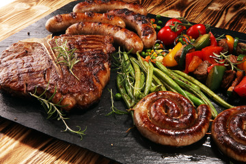 Assorted delicious grilled meat with vegetable on a barbecue with steak Wall mural