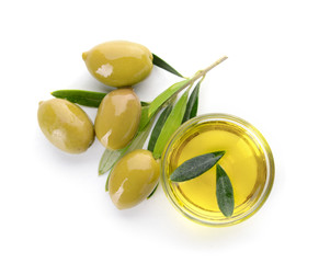 Bowl of tasty olive oil on white background