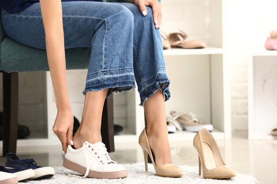 Young woman changing her shoes in dressing room