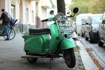 Fotorolgordijn Scooter vintage scooter in the street