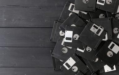blank floppy disks on wood background