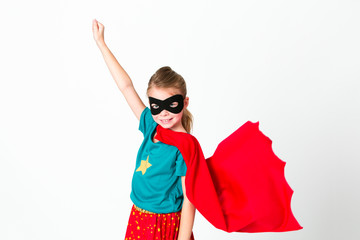 blond supergirl with black mask and red cape posing in front of white background