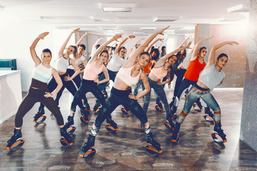 Group of girls with healthy habits doing exercises in kangoo jumps footwear. Your body can do it, it's your mind you need to convince.