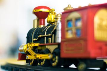 Toy plastic locomotive. Toy railway with train