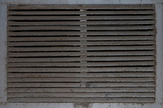 Background lattice of an old abandoned exhaust hood.