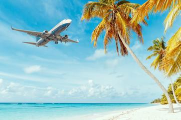 Fototapeta Airplane landing at resort