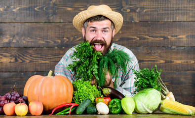 man chef with rich autumn crop. organic and natural food. happy halloween. bearded mature farmer. harvest festival. seasonal vitamin food. Useful fruit and vegetable. healthy food. cooking food