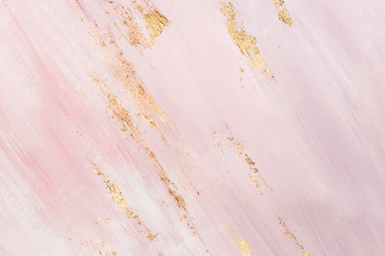 Delicate pink marble background with gold brushstrokes. Place for your design