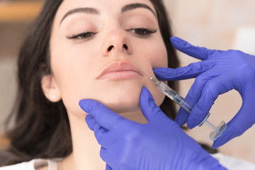 Woman having upperlip filler