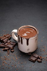 Printed roller blinds Chocolate Cup of hot chocolate and pieces of chocolat on dark concrete background