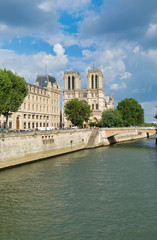 PARIS, FRANCE - JULY 2014: Exterior view of Notre Dame with tourists. This is the most visited landmark in France