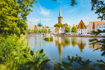 Fototapete - Historic city of Luebeck with Trave river in summer, Schleswig-Holstein, Germany