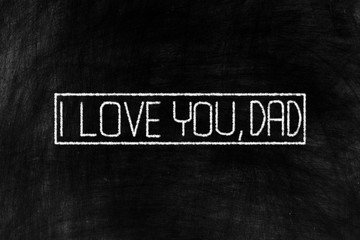 I Love You, Dad in Chalk Writing on Old Grunge Chalkboard Background, Suitable for Happy Fathers Day.