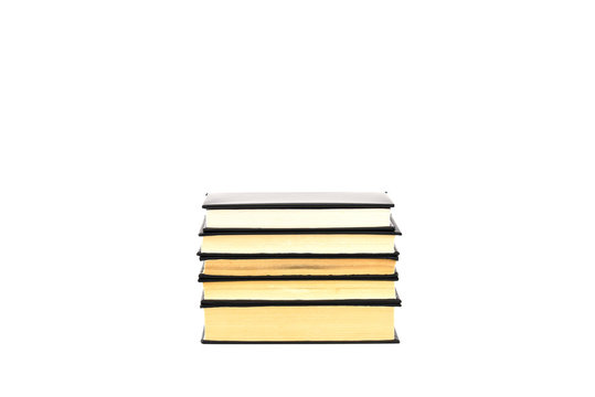 Old black hardcover books with yellow pages isolated on white