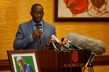 Tom Kabau the brother of Kenyan George Kabau who died in the Ethiopian Airlines crash sit next to his picture during a news conference where his lawyers announced they plan to file a wrongful-death lawsuit against Boeing, at the Serene hotel in Nairobi