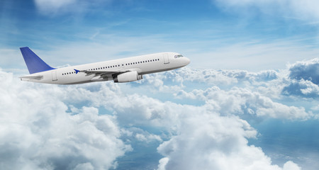 Commercial airplane jetliner flying above dramatic clouds. Wall mural