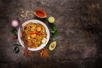 Vegetarian tofu asian food background on rustic stone background.