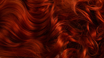 Red hair background. Curly red hair.
