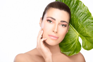 Skincare concept. Beauty spa woman and green leaf