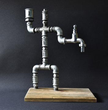 Handmade metal pipe alcohol fountain