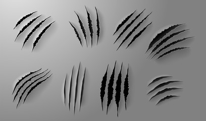 Set of Realistic scratch claws of animal. Hand drawn Animal's claws scratch scrape track. Hole in sheet of paper with torn edges. Vector illustration. Isolated on white background.