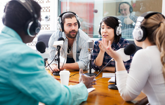 Radio hosts interviewing guest